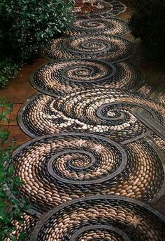 Paving artistic designs with pebbles www.pavingnature.com.au