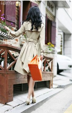 Adore the back of this trench! And the orange purse. I will own an orange hermes one day.