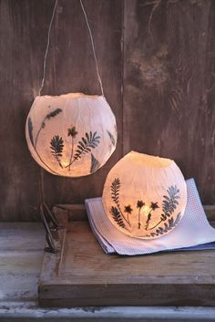 another luminaria idea...easy with tissue paper strips, white glue mixed with water, a balloon and dried flowers!