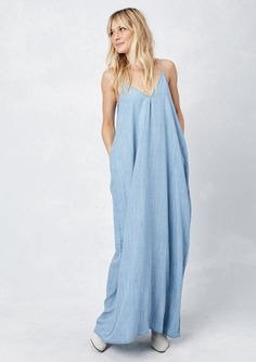 Our best selling, harem maxi dress with functional pockets! This classic favorite is now in super soft lightweight denim and has a billowy, comfy fit with a flattering silhouette! Features adjustable straps, and sexy, deep V-neckline. The perfect maxi dress!