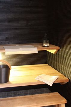 Sauna. Sormipaneelit (finger paneling?) on the walls look really good in black!