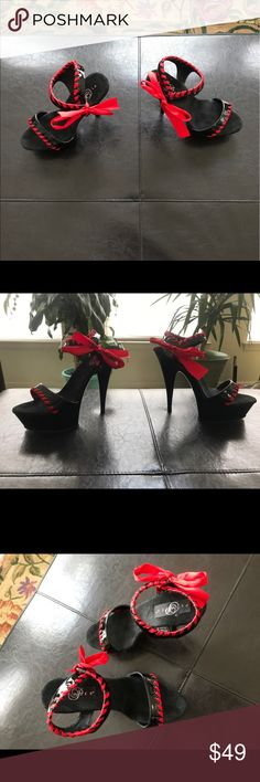 Pleaser sexy dancing 👠 Nice 4 1/2 inch sexy heels black shiny color sexy red lace to tie around ankles bottom platform is a suede material u will fall in love 😍 still looks brand new wore twice. Pleaser Shoes Heels