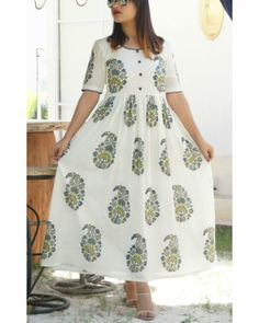 Buy The Secret Label Green Cotton paisley Anarkali Kurti online in India at best price. hite maxi dress with big paisley motif. The dress has a round neckline with a gathered waist for per Cotton Frocks, Cotton Gowns, Cotton Anarkali Dress, Vestidos Color Rosa, Simple Pakistani Dresses, Frock For Women, Kurta Designs, Indian Designer Wear, White Fashion