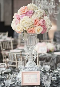 Pink peony wedding centerpieces with gold frame table numbers