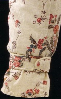 The patterned cottons of the eighteenth century imitated the realistic, open florals popular in silk brocades, and Indian exporters used Western pattern books to create painted cottons that imitated the brocade styles for export. These trendy Indian painted cottons were in turn imitated by English mills producing block-printed cottons! As the nineteenth century approached and skirts and bodices became smaller and narrower, these patterns completely superceded the larger, more dramatic…