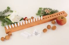 Charming idea — a minimalist advent calendar. Write a little note on the tiny rolls of paper, and each day the recipient has a special message to read.