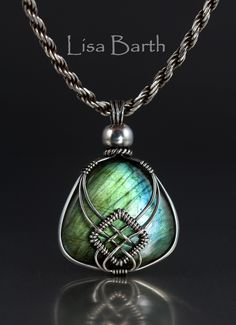 Here is another go at the Celtic version of the criss cross wire wrap. I just love Labradorite and this one is really bright.