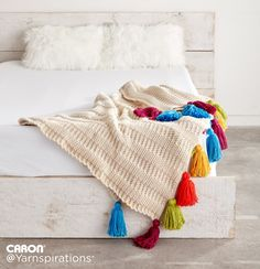 Caron Crochet Tasseled Throw - This subtly-ribbed blanket, crocheted in Caron One Pound, is accented by big and luxurious tassels. Get creative with color and customize the shades to your liking!