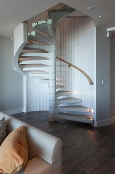 Beautiful concrete spiral staircase for a luxury coastal lodge in Cornwall. #spiralstair #concrete #spiralstaircase #coastalinteriors #design #architecture