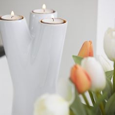 This clever, stylish piece starts as a vase. Flip it over, and it's a 3-candle holder!