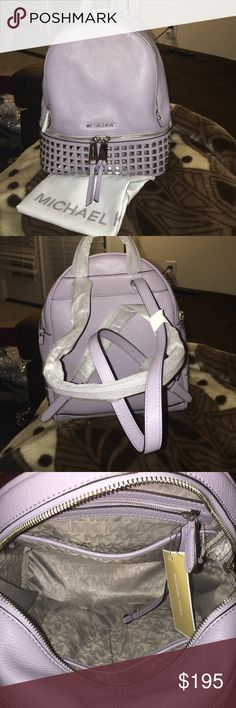 "MICHAEL KORS RHEA SMALL STUDDED LEATHER BACKPACK New with tags has dust bag never been used in great condition a lilac color with silver hardware and studs style 30S5SEZB5L  -Soft Venus Leather  -Silver-Tone Hardware  -10""W X11.75""H X 4.5""D  -2"" Drop  -8""-9"" Adjustable Strap  -Interior: One Padded Tablet Pocket, One Zip Pocket, One Key Fob  -Lining: 100% Polyester  -Imported Michael Kors Bags Backpacks"
