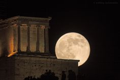 """The full moon rises above Athena Nike temple at Acropolis in Athens, Greece. The term """"supermoon"""" describes a full moon that coincides with perigee. The photographed full moon of 2013 June 23 was the largest of the year. However contrary to what the word supermoon might resemble, the angular size of the moon does not change that much. It's not noticeable to inexperienced eyes compared to other full moons of the year.... by Anthony Ayiomamitis,Perseus.gr"""