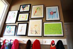 Kids artwork display and coat hooks by back door