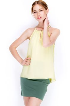 NAKED ZEBRA ROUND NECK SLEEVE LESS TOP, WITH KEY HOLE NECKLINE AND DECORATIVE FLOUNCES AROUND ARMHOLE  http://www.naked-zebra.com/country-living-top-32598.html