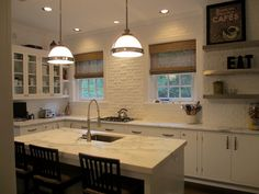 White painted brick wall and marble island