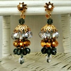 """Vendome Vintage Crystal Chandelier Earrings Amazing Vendome Vintage Crystal Chandelier Earrings. Clip ons with amber crystal studs holding three tiers of gold, silver and black crystal. Excellent condition. Measure approximately 2"""" long by .5"""" wide. Vintage Jewelry Earrings"""