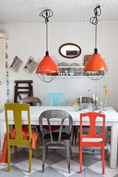 add color to the kitchen using leftover paint colors on chairs