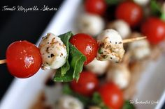 Tomato Mozzarella Basil Skewers  A favorite no-cook appetizer. They are quick and easy to pull together and they make an elegant and delicious small plate. No muss, no fuss. They're perfect for a Memorial Day cookout or if you just want to snack on them around the house.   Ingredients:      * fresh organic cherry tomatoes      * fresh organic basil      * marinated cherry size mozzarella balls      * balsamic vinegar      * skewers       * sea salt      * fresh cracked pepper  Wah-La! :)