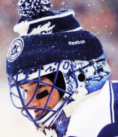 Goaltender Jonathan Bernier of the Toronto Maple Leafs defends the net against the Detroit Red Wings during the 2014 Bridgestone NHL Winter Classic on January 2014 at Michigan Stadium in Ann Arbor, Michigan. Hockey Goalie, Hockey Players, Ice Hockey, Maple Leafs Hockey, Nhl Winter Classic, Goalie Mask, Masked Man, National Hockey League, Toronto Maple Leafs