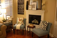 love color on wall & accent pillow...chairs have nice DIY detail with nail heads....