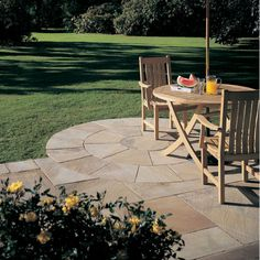 Bradstone natural sandstone sunset buff 2 ring circle squaring off kit. All the wonderful tonal subtleties and variations of sandstone, but rumbled to Concrete Stone, Concrete Design, Back Gardens, Small Gardens, Amazing Gardens, Beautiful Gardens, Sandstone Paving, Sandstone Cladding, Paved Patio