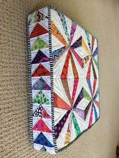 "Here's another way to use your fun Kaffe scraps.  My ""Crazy Cushion"" is paper pieced :)"