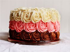 This is an amazingly beautiful cake, i love the details on the rose, it looks so pretty, i can't imagine eating it!