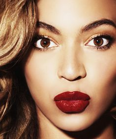 Take inspiration from Beyoncé by teaming deep red lips with shimmery gold eye makeup for an opulent wedding look.