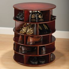 The 25 Pair Shoe Turntower - This is the elegant wooden tower that neatly stores up to 25 pairs of shoes and rotates a full 360° for easy access to all footwear. Its five levels are each subdivided into five cubbyholes large enough for storing men's or women's dress and casual shoes of all sizes and types. A spin of the smoothly turning tower quickly locates the pair you want.
