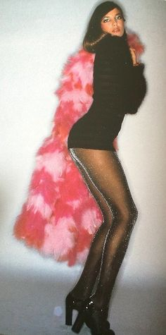 This shot is giving us serious 70s inspo-- maybe it's the pink fur coat or maybe it's the glittery tights?
