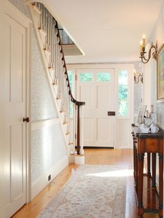 Home Renovation Project for Historical Farmhouse: Charming Entry With Staircase White Door Hearthstone Farm House ~ gozetta.com Architecture Inspiration