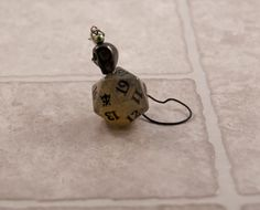 Smokey Black D20 Life Counter Dice Charm - Tabletop Gaming Bag Accessory with Skull Accent - Epic Dice Charm by TheDiceofLife on Etsy https://www.etsy.com/listing/484140064/smokey-black-d20-life-counter-dice-charm