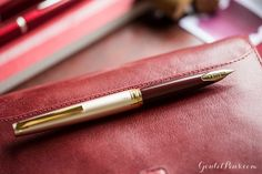 What a fountain pen! The Burgundy Pilot E95s boasts a vintage appeal with an inlaid gold nib. Post if for comfortable writing! This is a great purse or pocket pen. Pin for later.