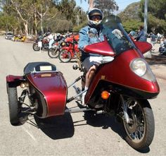 """Jerry Young matched his Honda Goldwing to a classic late 1970's Jacwal SuperWedge fairing, coloring matching it to Watsonian sidecar. Note """"shock absorbers"""" balancing out the combination."""