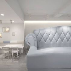 Japanese designers Nendo have completed the interior of a cafe for parents and their children in Aoyama, Tokyo, which features enormous, scaled up sofas.