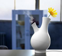 Nature Pot - It is a charming humidifier that integrates into your interior setup as a flower vase. Peacefully sitting atop your work desk or home, that moist sunny flower will sure make your day! Designer: Jeong Yong | #Humidifier #InteriorDesign #Vase |
