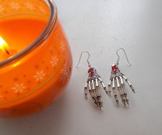 Halloween Skeleton Hand dangle earrings with Swarovski bicone beads by RicePaperJewels on Etsy
