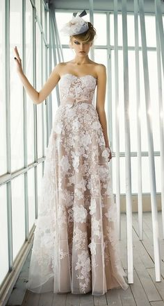 Floral lace prints on this Mira Zwillinger wedding gown.