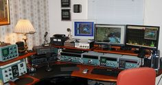 """he venerable old Heathkit HW101, my first radio, on the left, the """"acre of green"""" Heathkit SB104A on the right, both flanking a Yaesu FT920, and my field radio, a Kenwood TS570S, sitting on top. All three stations are fully operational. Presently my various VHF, UHF and packet stations are offline, mostly due to lack of use. There is a Yaesu dual band tranceiver tucked just to the right of the SB610 scope. The modern radios run through that scope too to monitor output quality, and the SB104A…"""