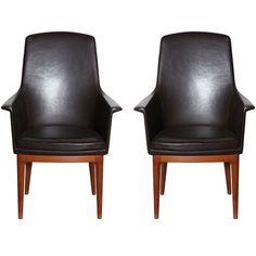 Swedish highback leather armchairs.
