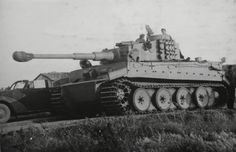 Tiger I ausf H with track links bolted to the side of the turret.