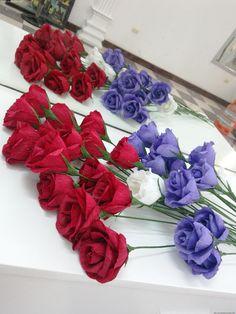 Rose paper flower Tutorial at https://www.youtube.com/watch?v=-3exYvjzd5U