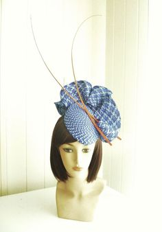 Blue straw headpiece, with orange feather quill