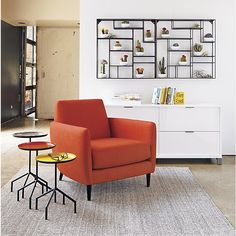Shop alcove wall shelf.   Nine sheet metal ledges suspend and intersect mondrian style on steel rods to frame objects of interest.  Raw look with powdercoated finish.  alcove wall shelf is a CB2 exclusive.
