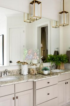 """Watching a favorite HGTV show in the master bath is easy, thanks to the 40x80 electric mirror over the vanity with a hidden 15.6"""" LED screen TV that disappears when not in use."""