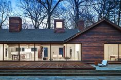 Burnt Is The New Black: Why Charred Wood (Shou Sugi Ban) Is So Hot Right Now - Explore, Collect and Source architecture & interiors Wood Siding, Exterior Siding, Rustic Exterior, 1960s House, Charred Wood, Casa Real, House Siding, House In The Woods, Long Island
