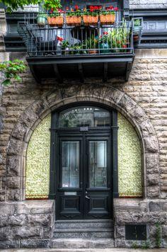 Montréal, Québec, beautiful building and beautiful balcony with geraniums,  etc.