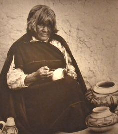 """Iris Nampeyo (ca. 1860–1942) was a Hopi-Tewa potter who lived on the Hopi Reservation in Arizona. She was better known by her Tewa name, Num-pa-yu, meaning """"Snake that does not bite."""" She developed her own style based on traditional designs. Her work is in the Smithsonian Institution and is collected worldwide. In 1904 and 1907, she produced and sold pottery at the Grand Canyon lodge. She and her husband traveled to Chicago in 1898 and 1910 to display her work."""