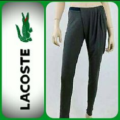 "Lacoste Sport Women's Yoga Pant Not just for workouts, these pants are great for work as well. Look fabulous in these distinctive yoga pants, with an asymmetrical ruched waistline. Features Easy Mov', Easy Dry fabric. Reliable essentials like these are the reason you can't beat Lacoste Sport. MSRP $110.   Details: ☆Size: 10  ☆Contrasting Navy accent banded waistband ☆Layered ruched detail over waistband ☆Croc icon logo sewn at waist ☆Rise: 9.5"" ☆Inseam: 31"" ☆67% lyocil, 33% cotton ☆Machine…"