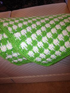 """Finished afghan in """"Larksfoot Stitch"""".  I used Redheart super saver yarn in Spring Green and Caron Pounder in Antique White (it might have been Off White) For the edging I single crocheted all around and then reverse crocheted once more all around. Love this stitch and learned  from Crochet Geek on You Tube."""